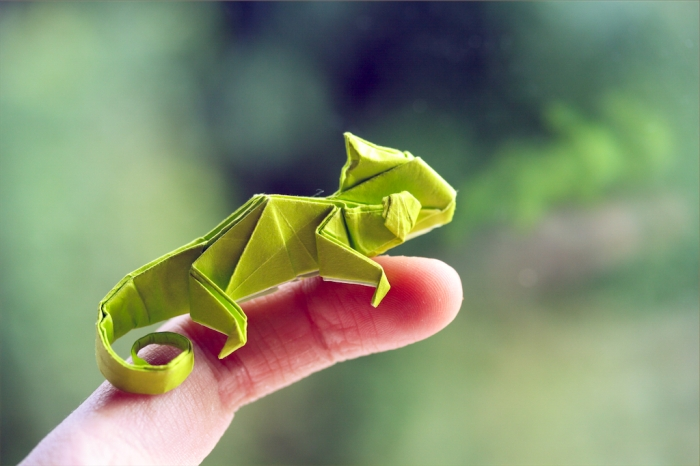 pablito, green origami chameleon sitting on my finger, designed by Quentin Trollip