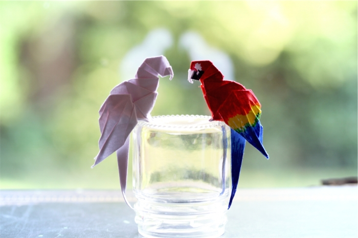 plain white and scarlet origami macaws, designed by Gabrielle Chan