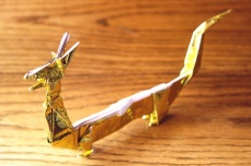 zodiac, golden origami chinese dragon, designed by John Montroll