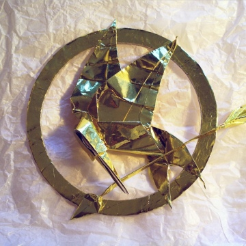 golden origami mockingjay pin, designed by Gabrielle Chan