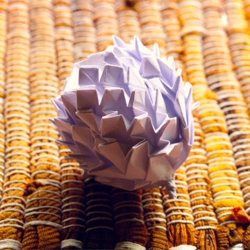 white origami pinecone, designed by Beth Johnson