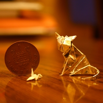 smaller and smaller, miniature origami cat and crane, designed by Anibal Voyer