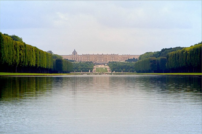 lake and palace of versailles, france