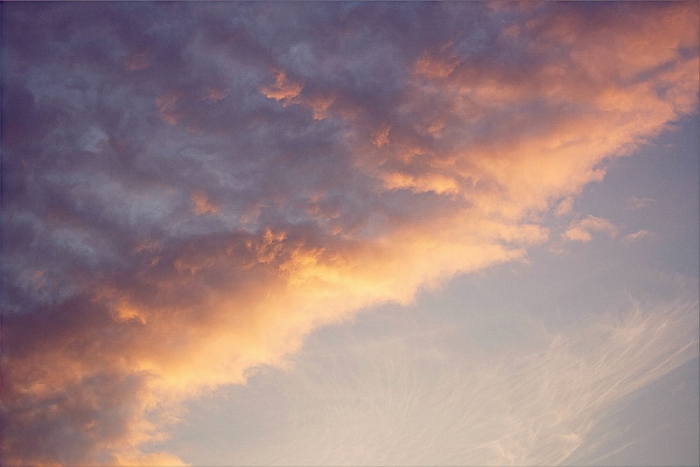 scattered clouds in the summer evening light