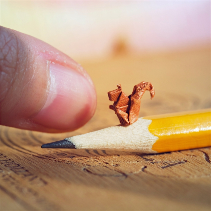 52 weeks of tinygami, miniature origami squirrel sitting on a pencil